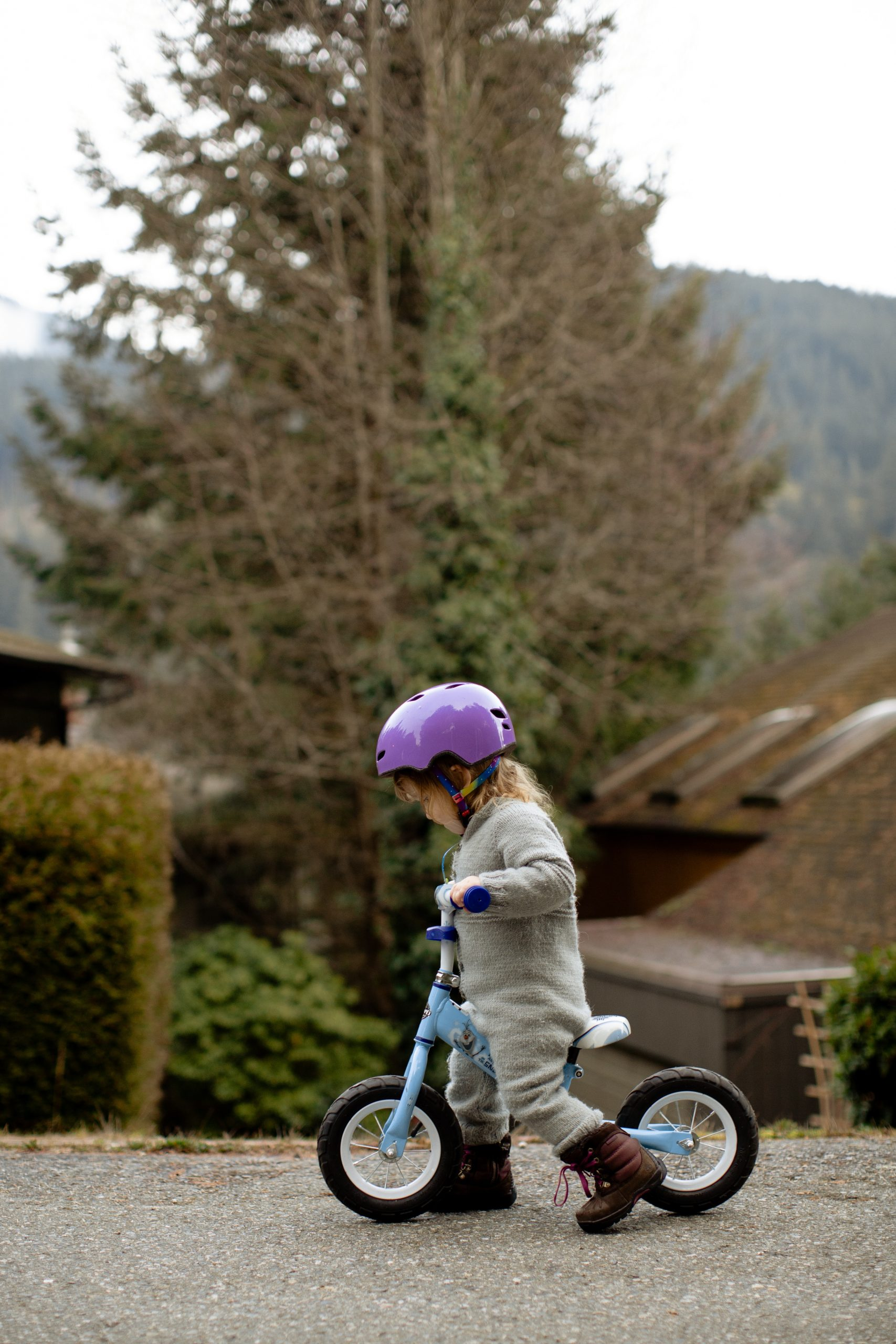 Child on bike in pink helmet